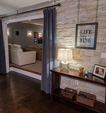 A remodeled basement by Stoeck Interiors.